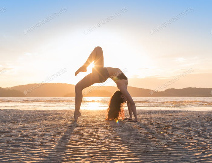 Young Girl Practicing Yoga On Beach At Sunset, Beautiful Woman Summer Vacation Meditation Seaside