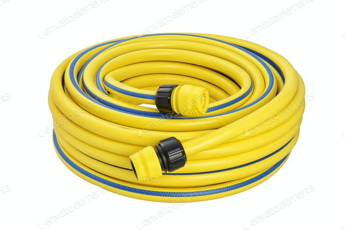 Yellow coiled rubber garden hose with quick-connector system isolated on white background