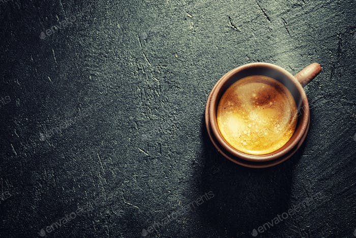 Cup of fresh made coffee served in cup
