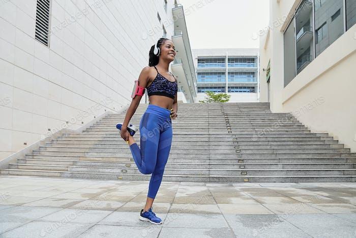 Happy African-American sportswoman