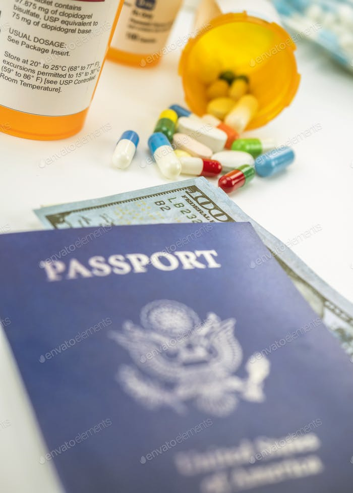 American passport along with several bottles of medicines, conceptual image, horizontal composition