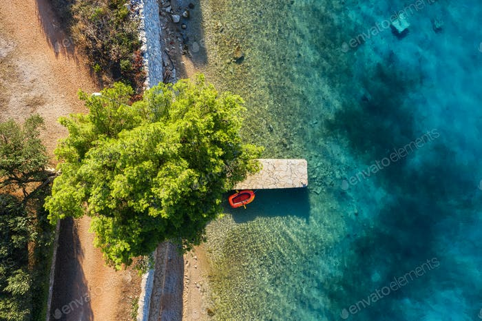 Croatia. View on the berth from drone. Aerial view of floating boat on blue sea at sunny day.