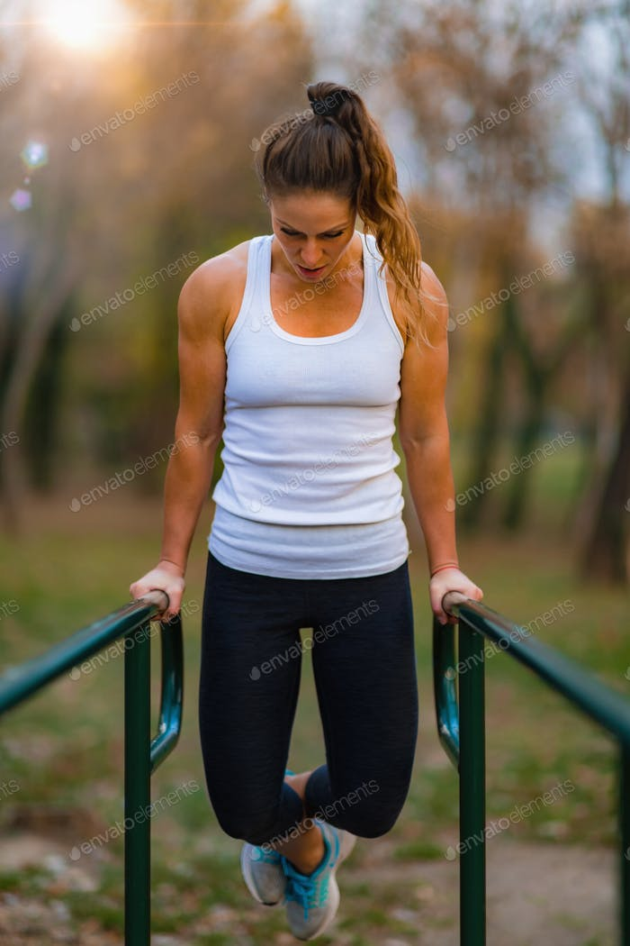 Exercising on Parallel Bar, Outdoor Gym