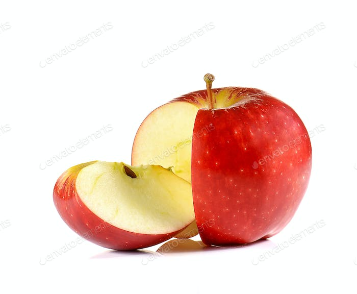 Red Apple cut pieces on white background.