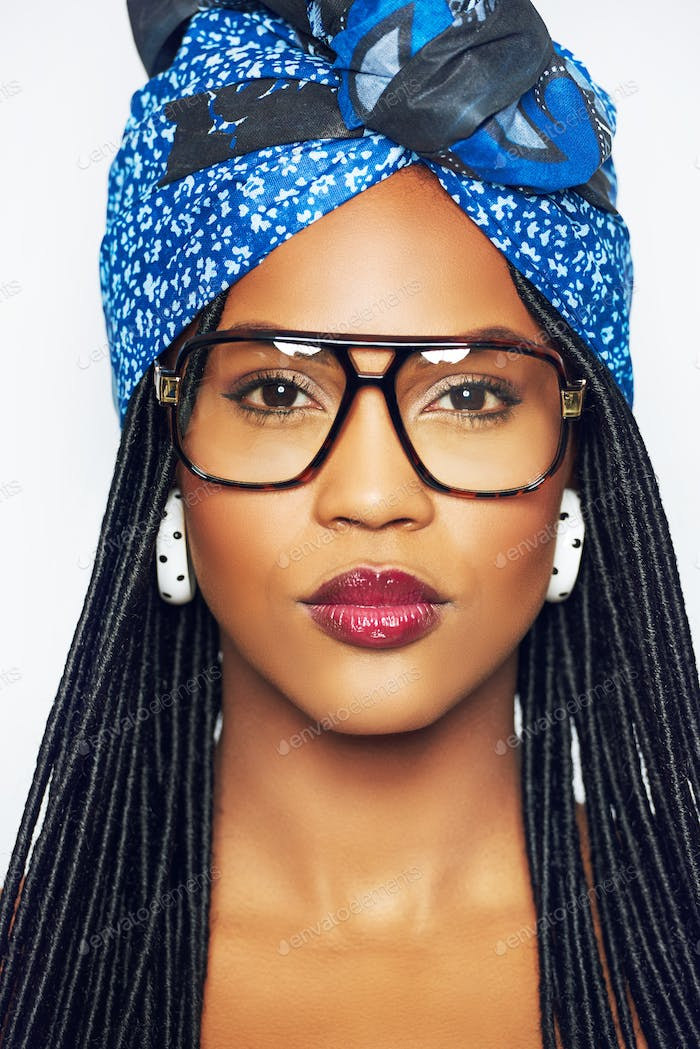 Black woman in glasses and headscarf
