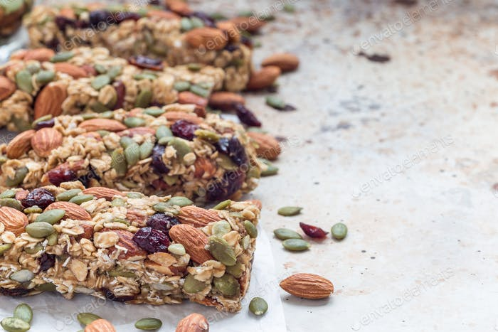 Homemade granola energy bars with figs, oatmeal, almond, dry cranberry and pumpkin seeds