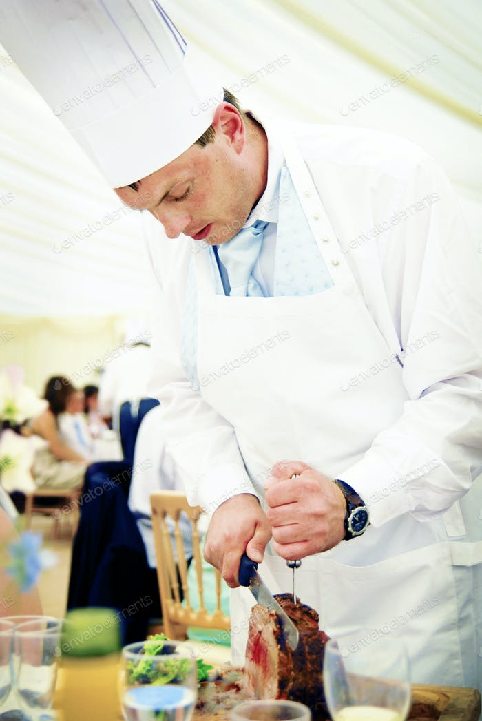 Chef Carving Beef at a Wedding Reception Concept