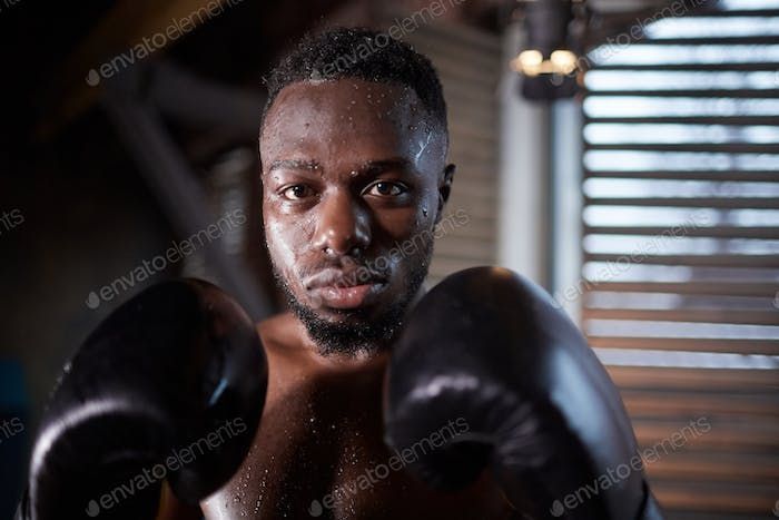 African sportsman in boxing gloves