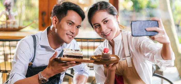 Banner of Couple Asian two partner of small business owner taking selfie and presenting the bakery