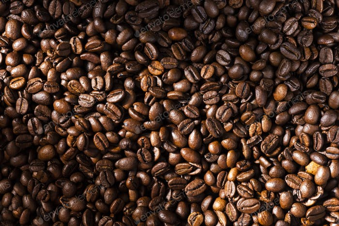 Roasted Coffee Beans Background Texture in Warm Light