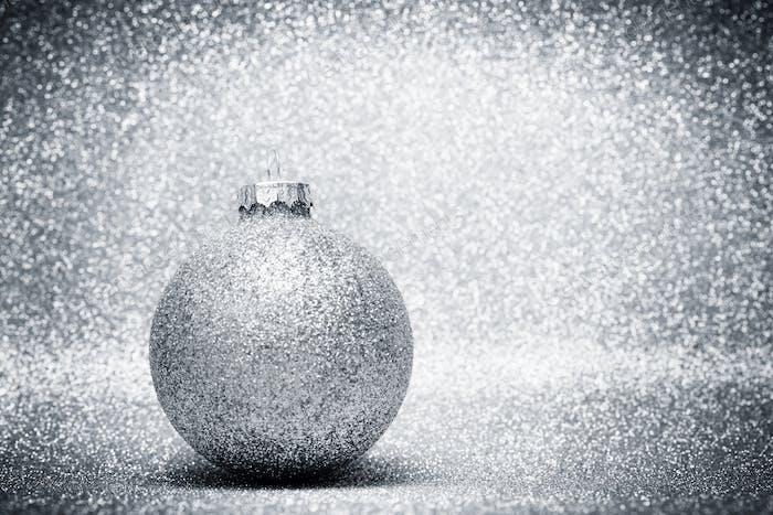 Christmas glass balls decoration on silver glitter background