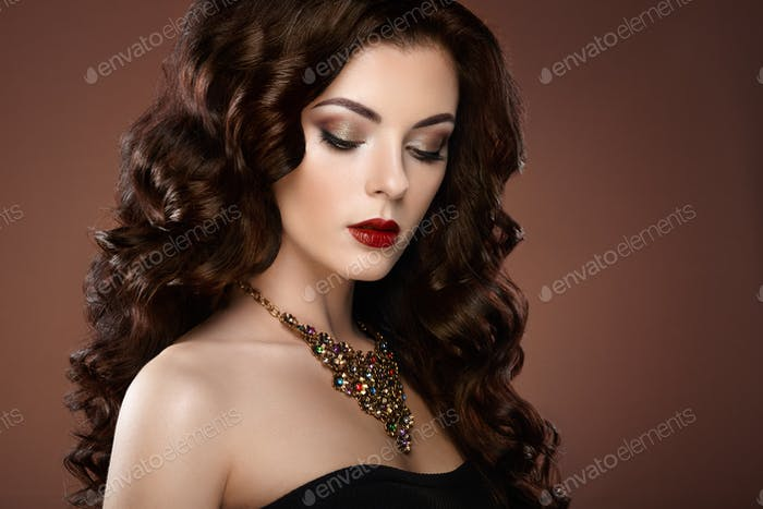 Brunette woman with curly hairstyle