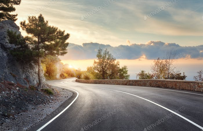Mountain road with a perfect asphalt at sunrise