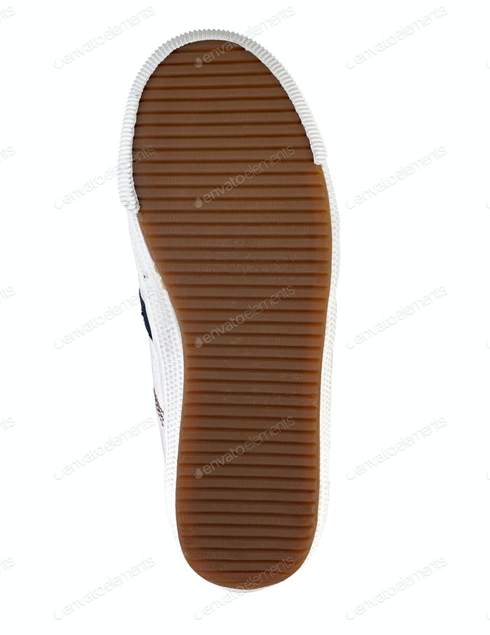 Brown sole of a shoe on a white background
