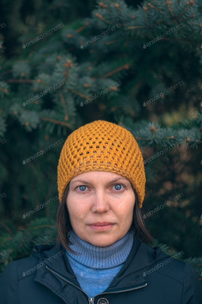 Beautiful woman in 40s headshot portrait in park