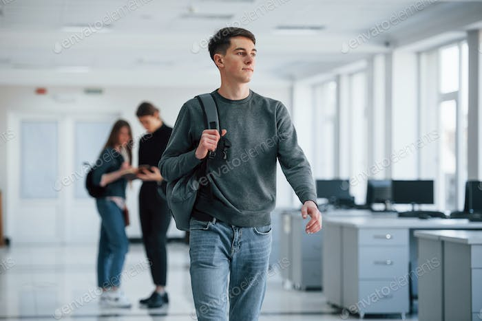 Caucasian ethnicity. Group of young people walking in the office at their break time