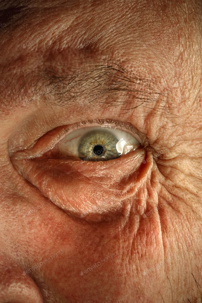 Close-up view on the eye of senior man.