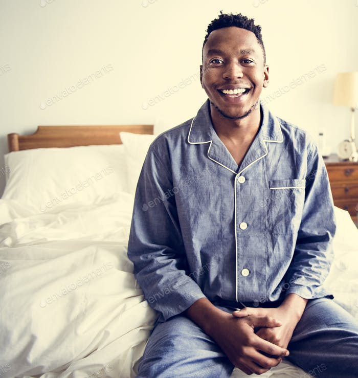 A smiling man in bed