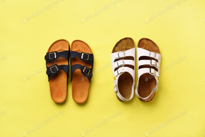 Summer female shoes - sandals (birkenstock) and slippers on yellow background with copy space. Top