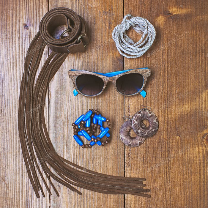 Fashion accessories on vintage wooden surface