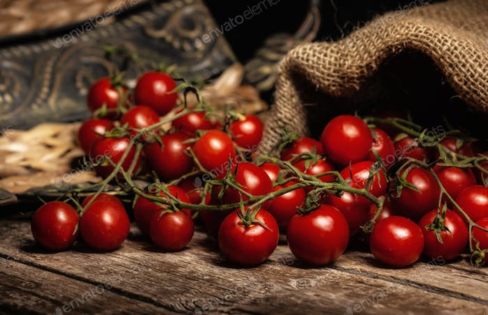Still life of cherry tomatoes on wooden table.