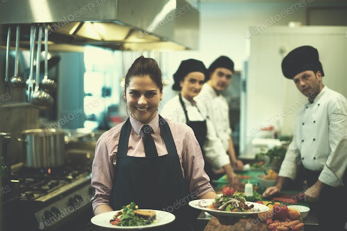 young waitress showing dishes of tasty meals