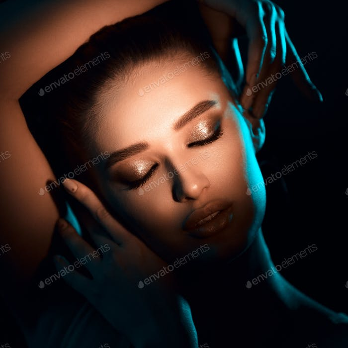 Woman In Shadow. Light On Eyes With Beautiful Makeup