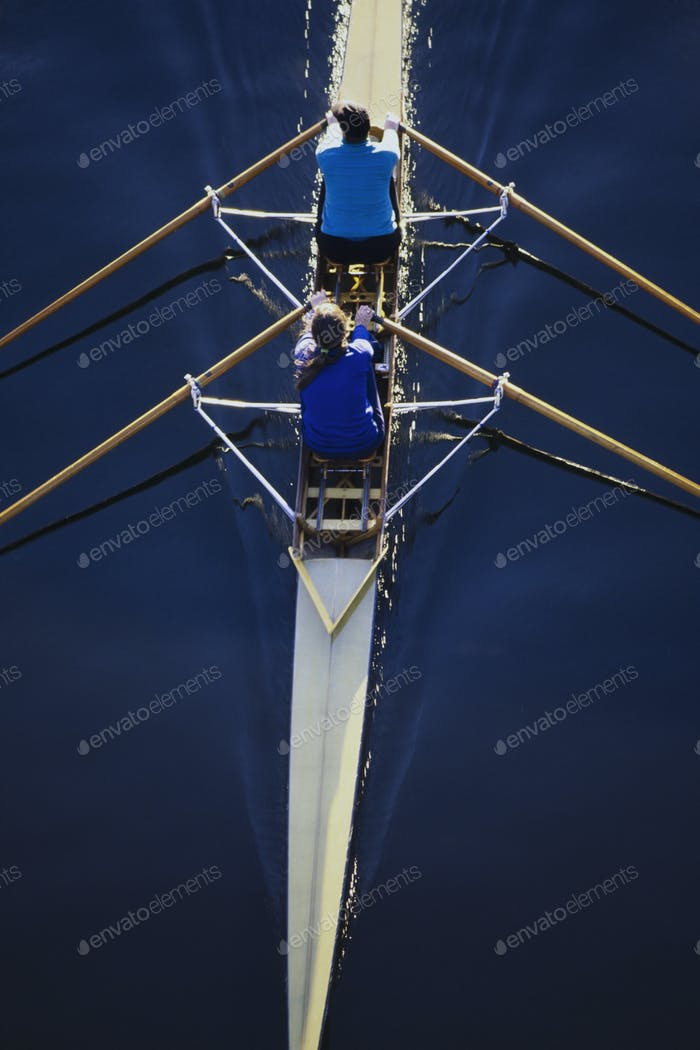 Overhead view of women rowing double scull boat during competitive race in Seattle.