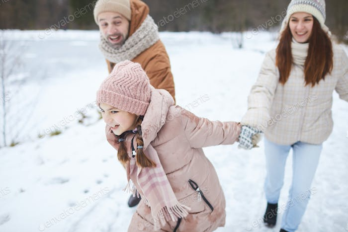 Carefree Family Playing in Winter Park