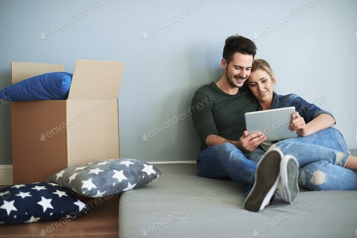Young couple in new house making decisions