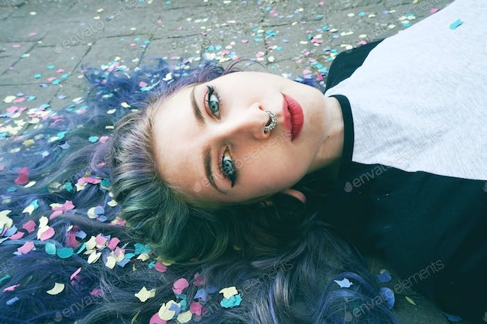 Beautiful young woman surrounded by confetti
