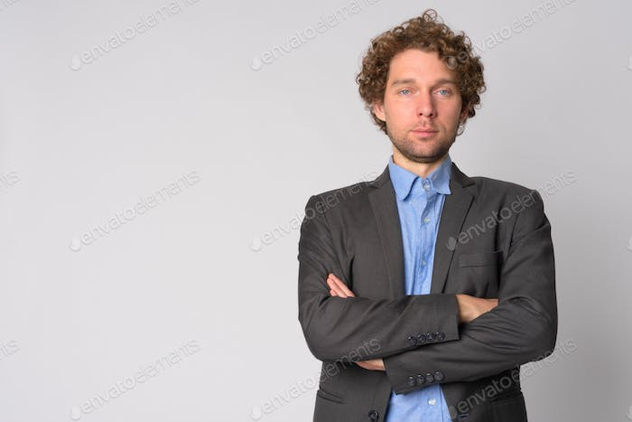 Portrait of handsome businessman with arms crossed