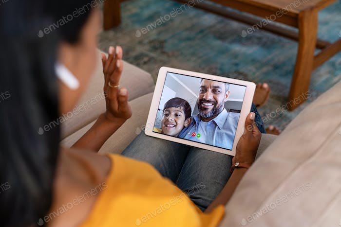 Woman doing video call with her family