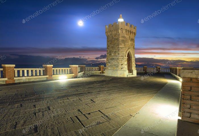 Piombino piazza bovio lighthouse and Elba Island and moonlight. Tuscany Italy