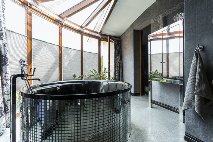 Luxurious bathroom with freestanding glossy bathtub