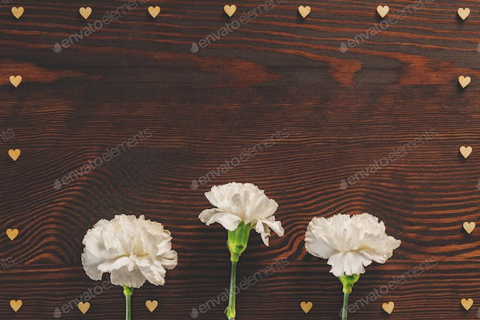 White carnations and decorative hearts