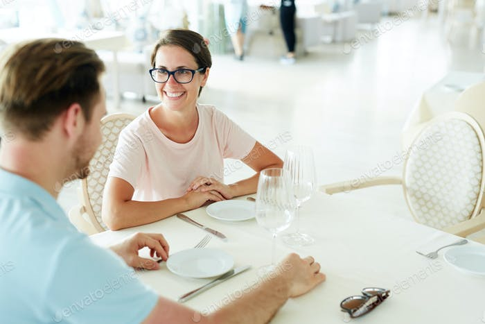 Couple Waiting for Food in Restaurant