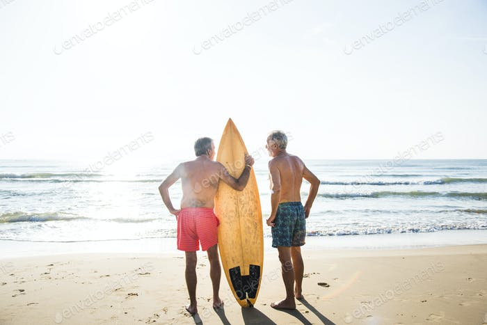 Mature surfers at the beach