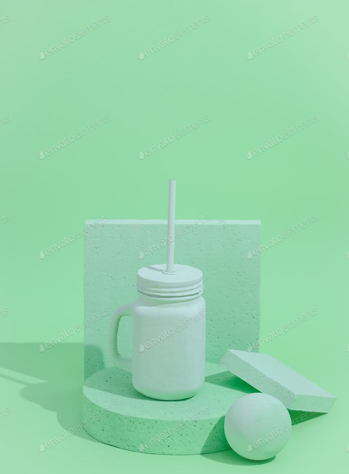 Minimal aesthetic still life monochrome design. Aqua Menthe trends.  Smoothie mug and abstraction