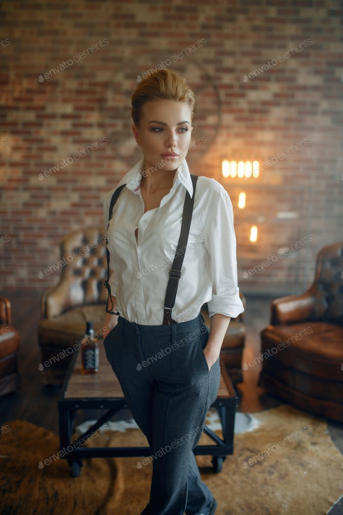 Woman in strict clothes in studio, retro fashion