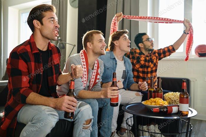 Football fans watching football game