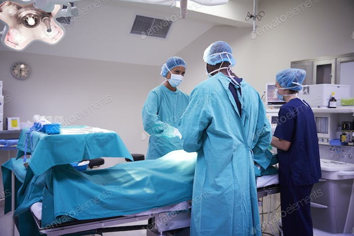Surgical Team Working On Patient In Hospital Operating Theatre
