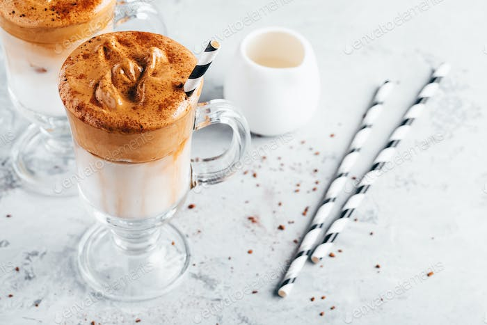 Dalgona coffee. Iced coffee with creamy whipped foam and almond milk.