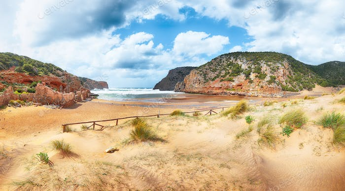 Charming view of beach Cala Domestica  with marvelous sand dunes.