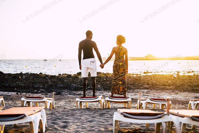 black race african american couple in romance time with sunset at the beach