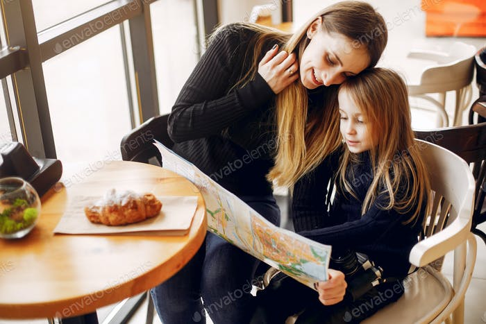 Cute and stylish family in a cafe