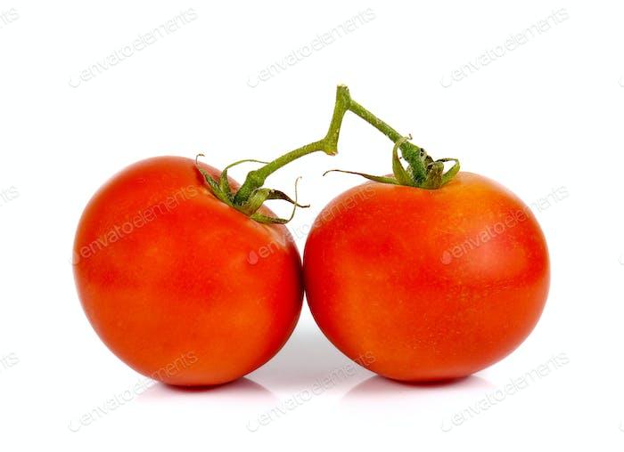 Tomatoes cut half,tomatoes full balls on white background.