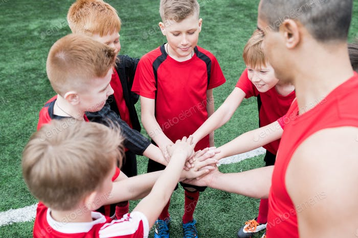 Kids Joining Hands before Match