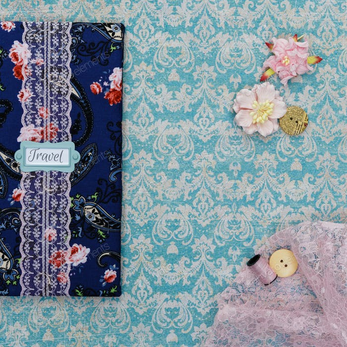 Scrapbooking holder for travel documents on floral paper