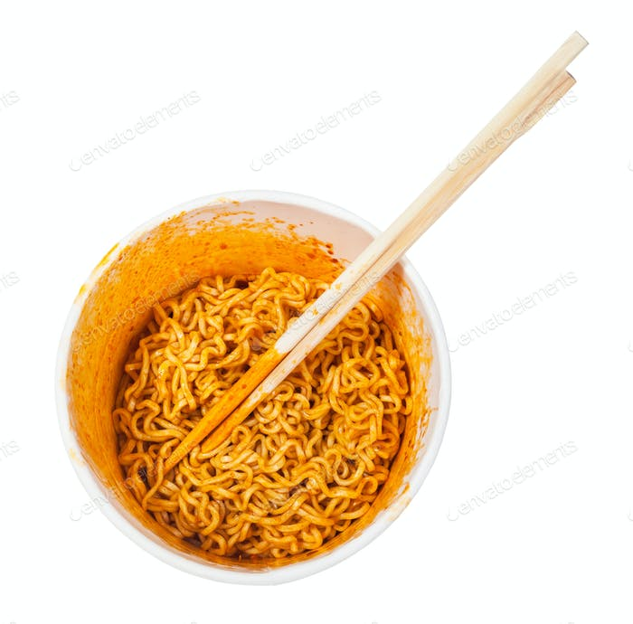 chopsticks in cup with spicy instant noodles